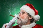 Bad Santa Lighting A Cigar — Stock Photo