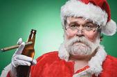 Bad Santa WIth A Beer And Cigar — Stock Photo