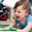 Baby playing on a jungle mat — Stock Photo