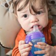 Baby With Sippy Bottle - Stock Photo