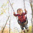 Toddler Swinging In The Fall — Stock Photo