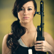 Militarized Young Woman WIth Assault Rifle — Stock Photo