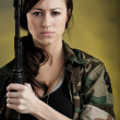 Militarized Young Woman WIth Assault Rifle — Stock Photo #25083803