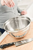 Salting in the kitchen — Stock Photo