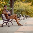 Man Relaxing In The Park Reading E-Reader — Stock Photo