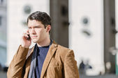 Man Talking On Cellphone At The Station — Stock Photo