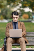 Man Relaxing In The Park, Working On Laptop — Stock Photo