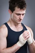 Pensive Fighter Checking His Tape Wraps — Stock Photo