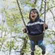 Toddler Boy Swinging In The Early Spring — Stock Photo