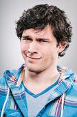 Man smirking uncomfortably — Stock Photo