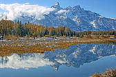Mirror reflection with mountains and clouds ,Grand Teton National Park, Wyoming — Stock Photo