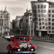 Vintage Car and dancing house in Prague - Stock Photo