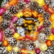 Stock Photo: Christmas wreath with pine cones and flowers