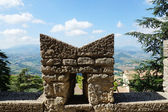 Fortified wall and a view of the city at the foot of San Marino, — Stock Photo