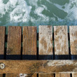 Wooden pier leading into the blue sea — Stock Photo