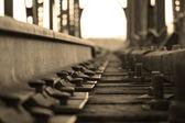 Railway sleepers and rails, b & w — Stock Photo
