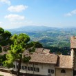 Stock Photo: Tiled roof and panoramic view from walls of S- Marino,