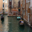Venetian canals with gandolerami, Venice, Italy — Stock Photo