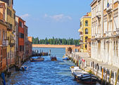 Canal in Venice and motorboats, Italy, Europe — Stock Photo