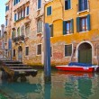 Narrow canal with boats in Venice, Italy — Stock Photo #38046499