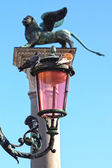 Lantern and lion on the Piazza San Marco, Italy — Stock Photo
