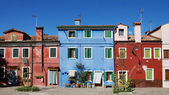 Colored facade of the island of Burano in the background of blue — Photo