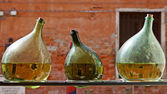 Three green bottles with reflection of Venice, Italy — Stock Photo