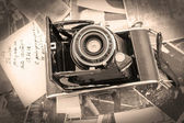Retro camera on the background of old photos — Stock Photo