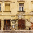 Facade of the old dilapidated house — Stock Photo #49308173