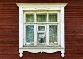Old window of a wooden house — Stockfoto