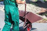 Worker with a wheelbarrow — Stock Photo
