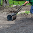 Working with lawn roller — Stock Photo