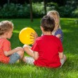 Children playing outdoors in spring park — Stock Photo