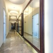 Huge mirror in a corridor of modern house — Stock Photo #27617039