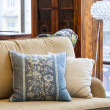 Blue and cream pillows — Stock Photo