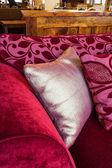 Silver pillow on a sofa — Stock Photo