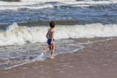 Boy and waves — Stock Photo