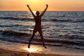 Jumping at sunset — Stock Photo