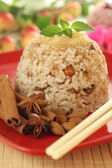 Rice dessert with almonds — Stock Photo