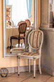 Mediterranean interior - mirror and chair — Stock Photo