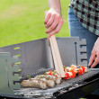 Stock Photo: Cook grilling