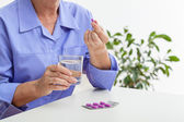Woman taking pills — Stock Photo