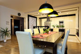 Urban apartment - Wooden table in dining room — Stock Photo