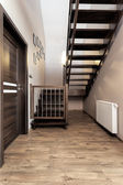 Urban apartment - wooden stairs — Stock Photo