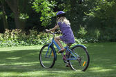 Girl riding a bike — Stock Photo