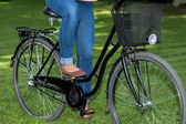 Woman on a bike — Stock Photo
