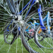 Bikes seen through spokes — Stock Photo