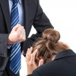 Clamped fist above an employee — Stock Photo