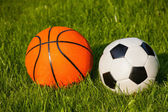Basketball and football balls — Стоковое фото
