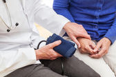 Checking blood pressure — Stock Photo